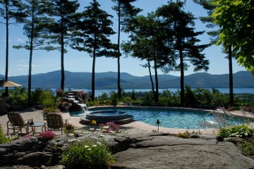 Natural stone used in the landscape with pool and waterfall overlooking Lake George